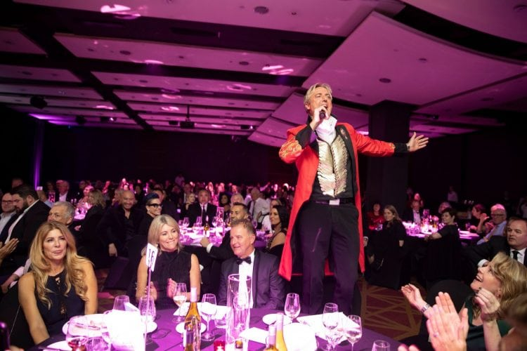 Geoff Sewell performing at a corporate event entertainment